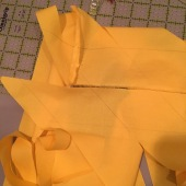 """Extend 'cut"""" by marking fabric to the cut to the selvege. Shift fabric to create tube"""